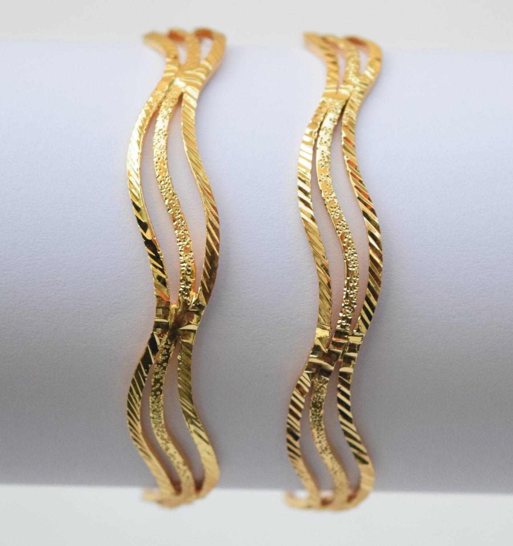 Sleek Golden designer bangles pair BN154 1